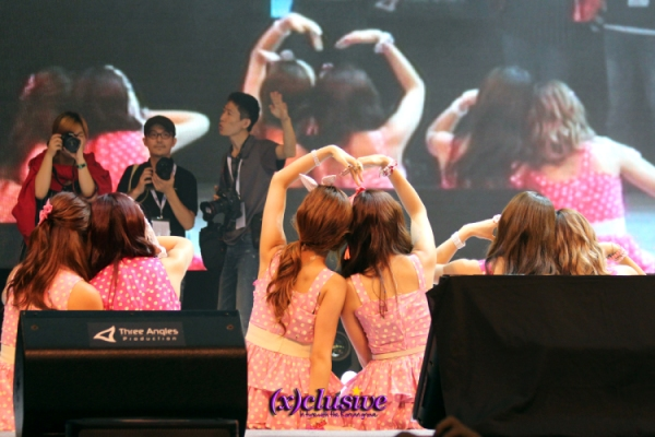 A-Pink taking a photo with fans