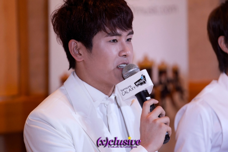 Charismatic dance machine Hoya addressing the media