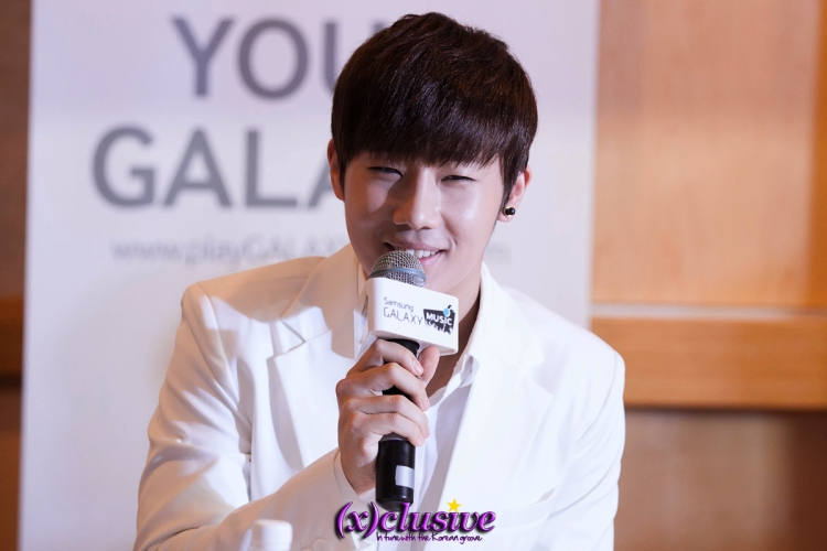 Leader Sunggyu, foodie of the group, looking excited as he talks about Singaporean food